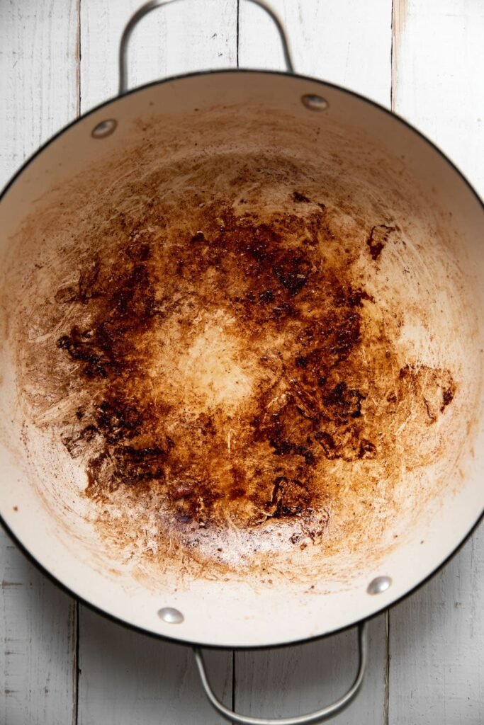 cooking pot showing what it looks like after cooking a chuck roast in it