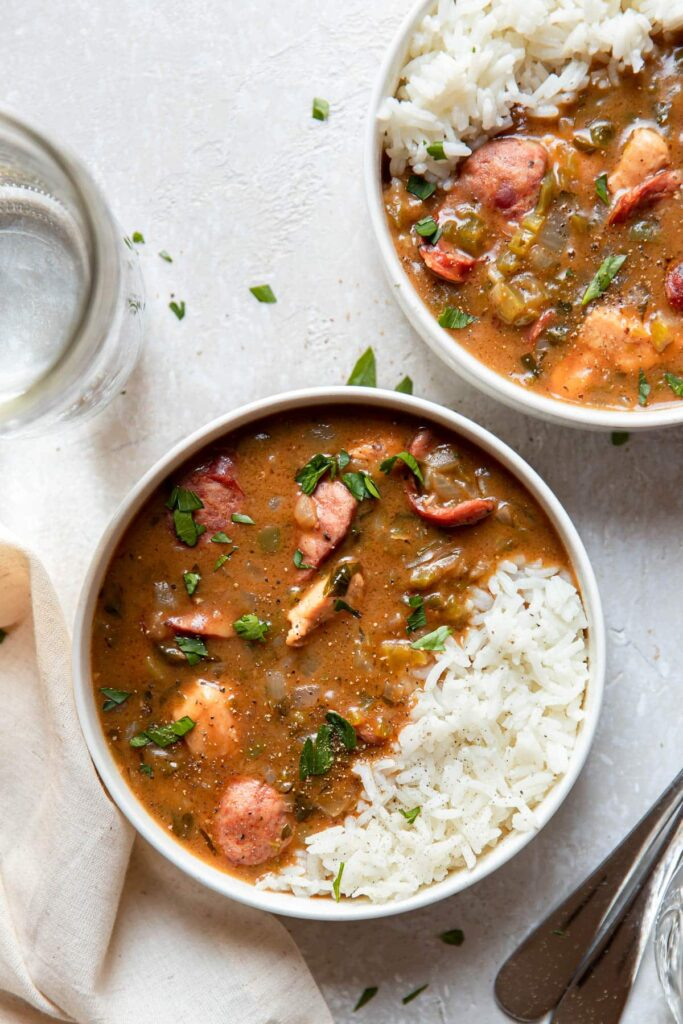 chicken and sausage gumbo in a bowl with rice