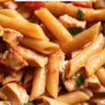 Penne pasta in a lemon sauce with chicken and fresh basil.