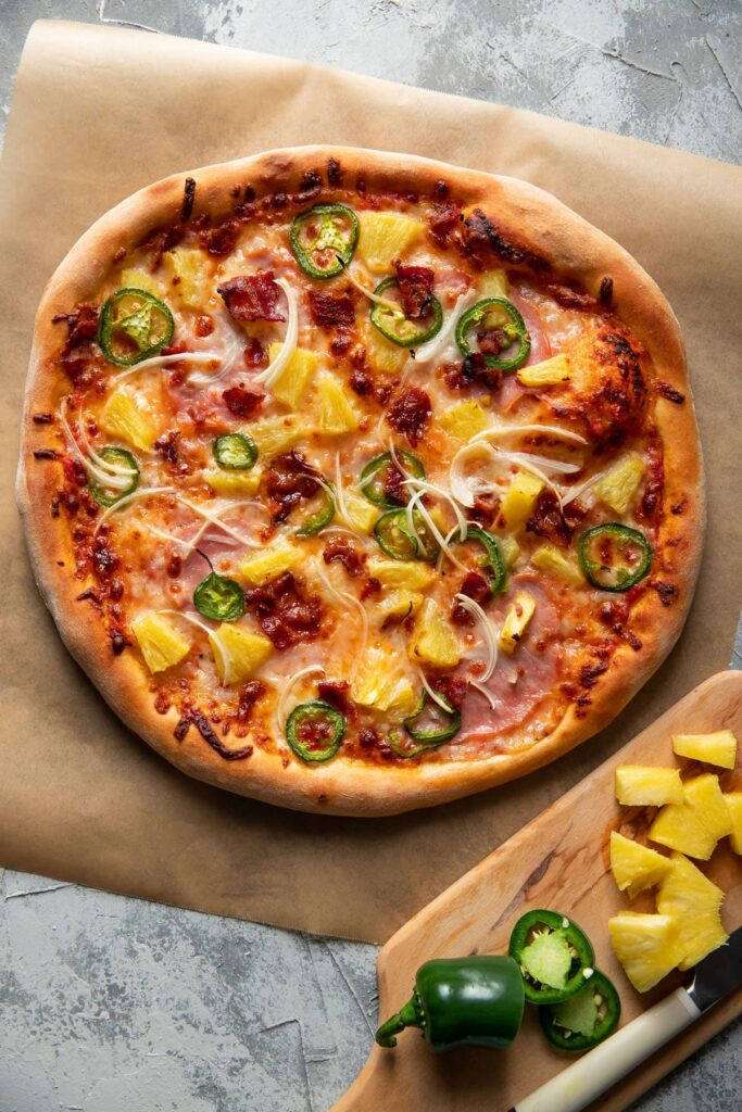 mellow mushroom style pizza with pineapple jalapeno and bacon on top