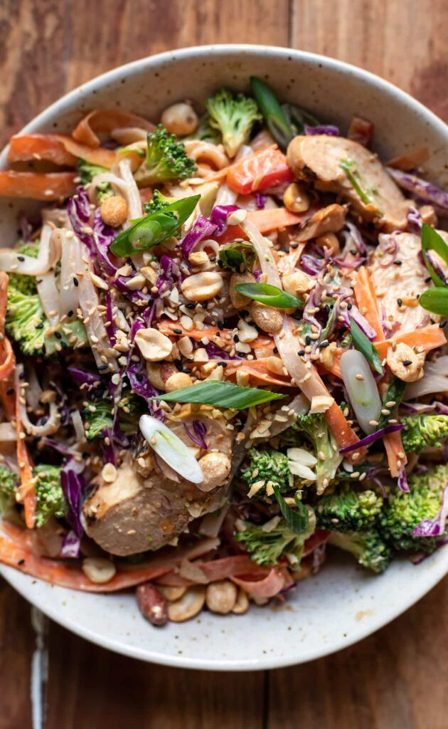 asian chicken salad with rice noodles and vegetables