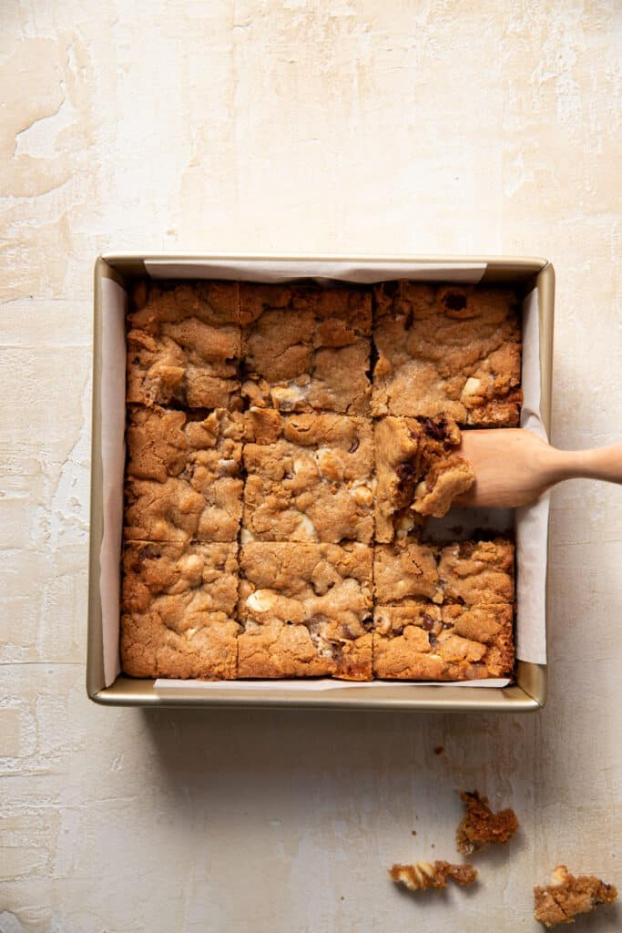 s'mores cookie bars in a square baking pan cut up