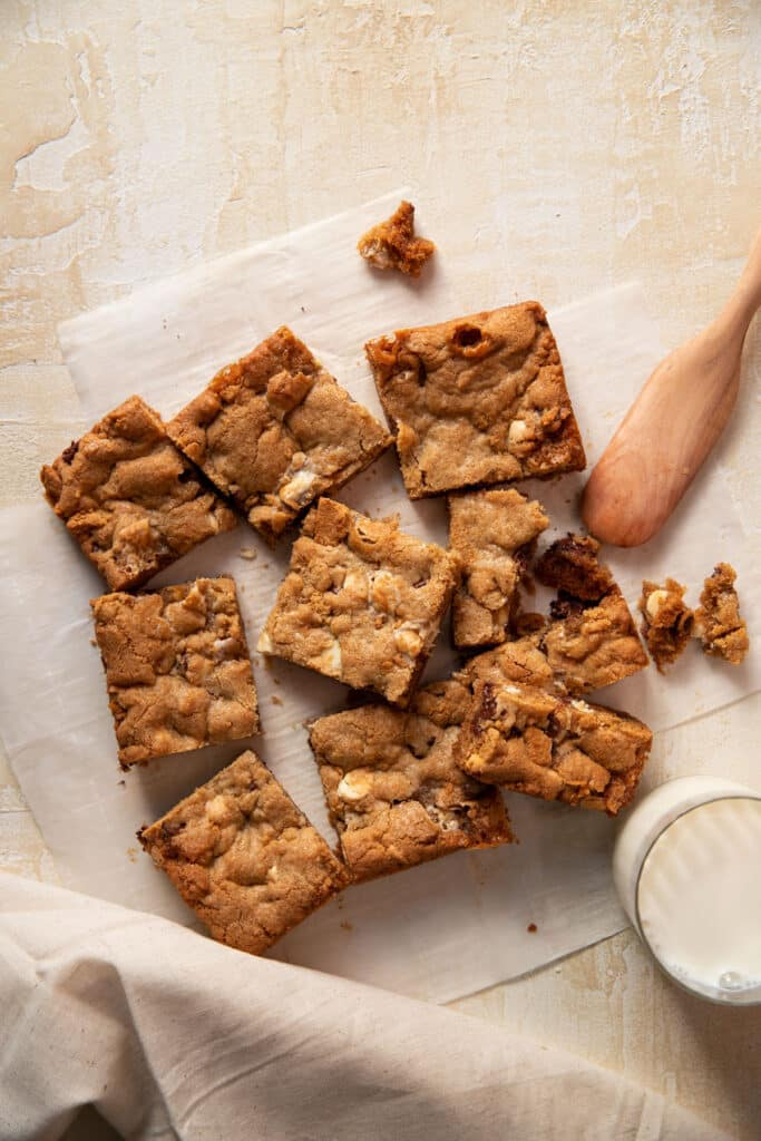 s'mores cookie bars on a piece of parchment paper cut into squares
