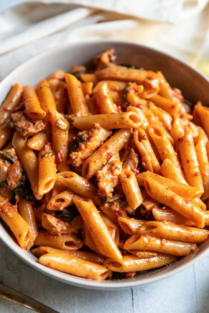 pasta and chicken in a sun dried tomato cream sauce
