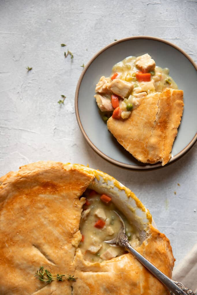 chicken pot pie in the dish and on a plate
