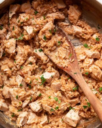 chicken and risotto in a saute pan