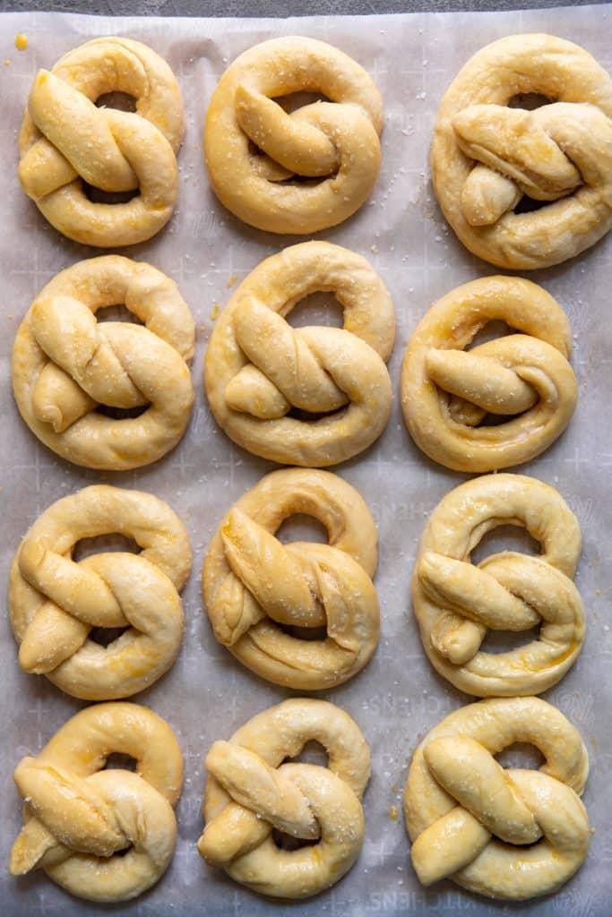 pretzels on a baking sheet before baking