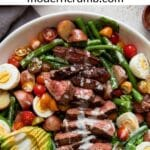 steak salad and vegetables in a white bowl