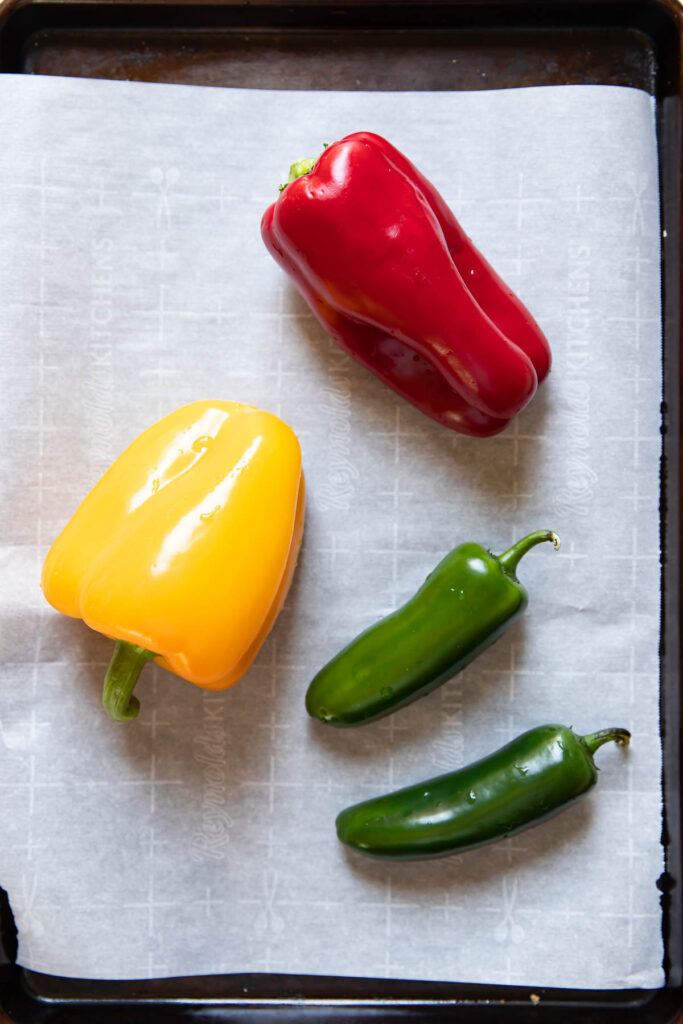 Bell peppers on a baking sheet.