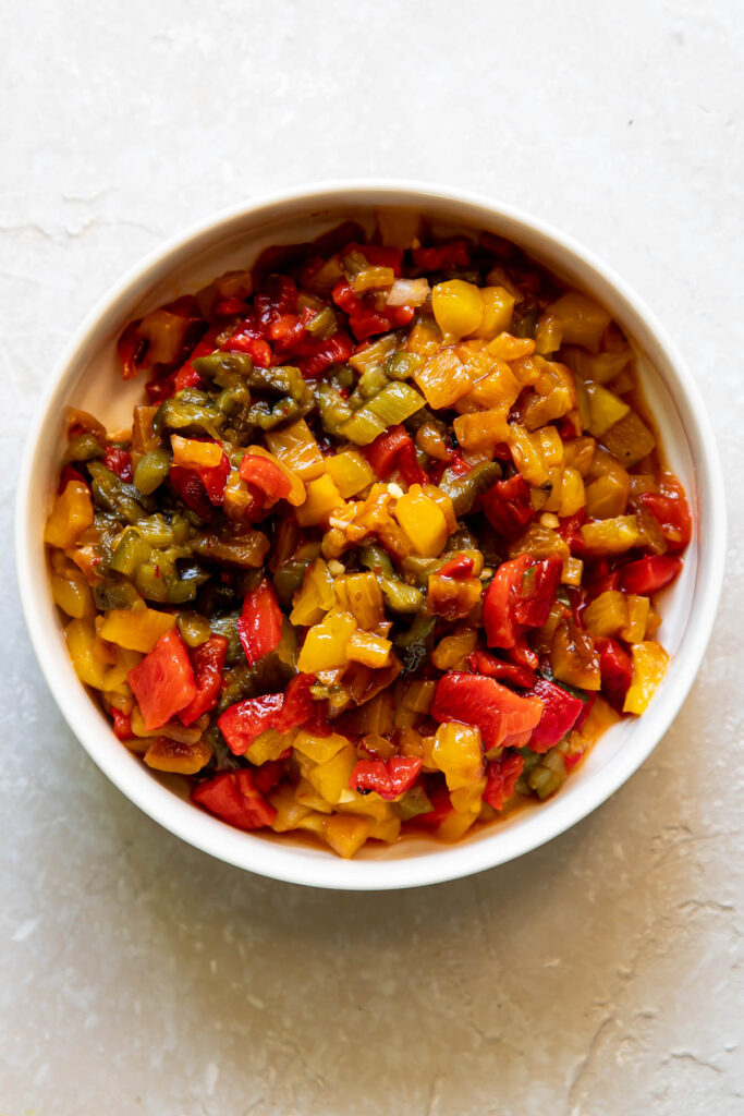 Bowl of chopped up roasted bell peppers.