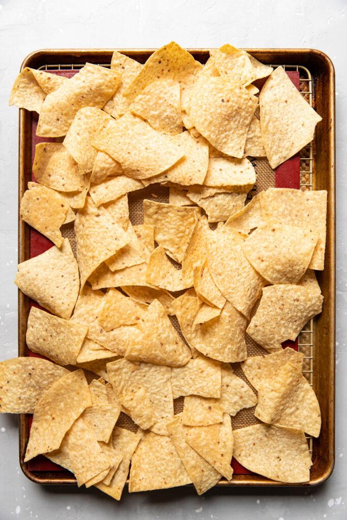 tortilla chips on a baking sheet.