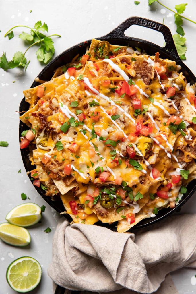 carnitas nachos in a skillet.
