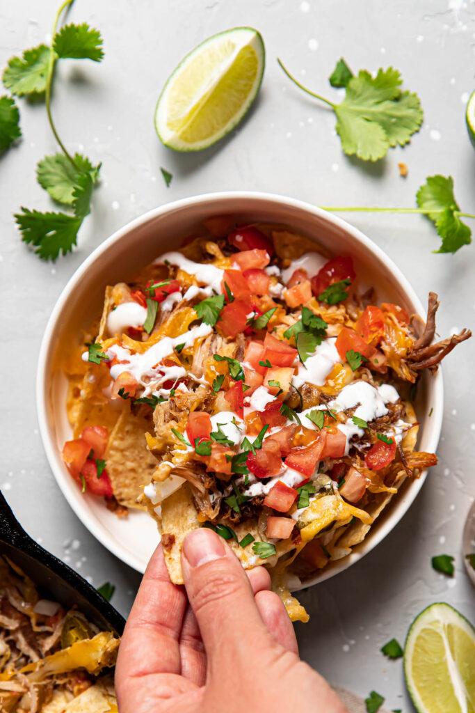 carnitas nachos in a bowl.