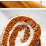 pumpkin roll sliced to see the cream cheese swirl