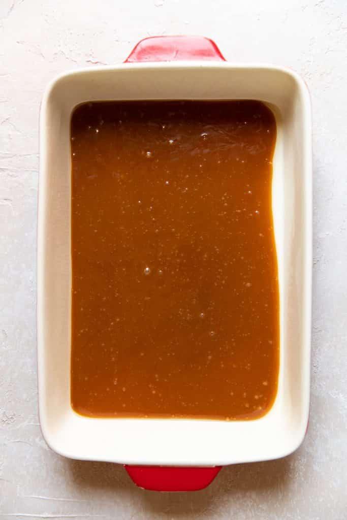 caramel sauce in a baking dish
