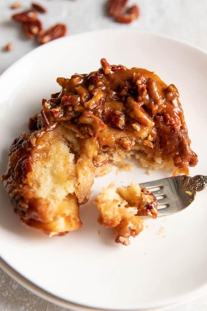 pecan sticky bun on a plate