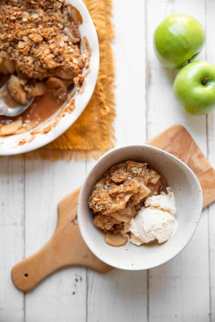 bowl of apple crisp and vanilla ice cream