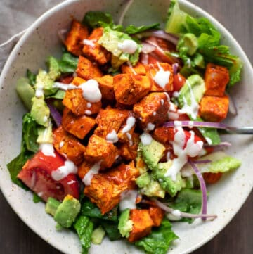 buffalo chicken salad with carrots tomatoes and celery in a bowl