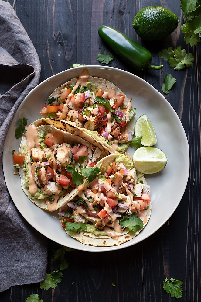 chicken street tacos with guacamole and chipotle aioli