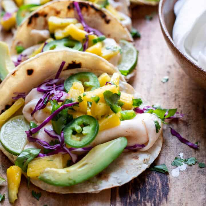 street tacos filled with chili lime coconut meat avocado and pineapple