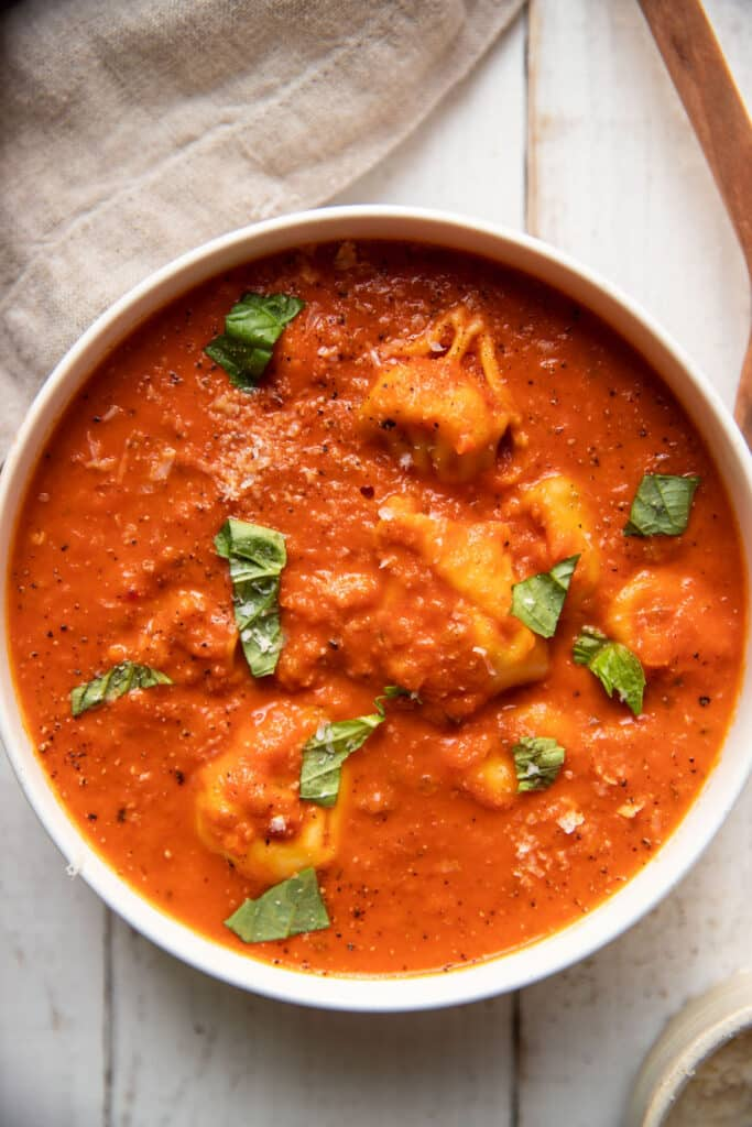 creamy tomato red pepper soup with tortellinis and fresh basil