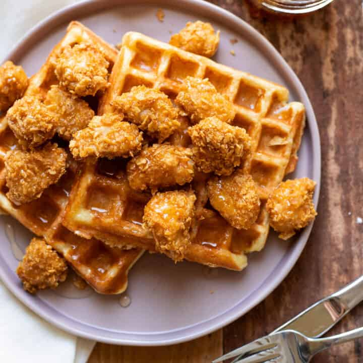 crispy baked chicken nuggets and buttermilk waffles with sriracha honey