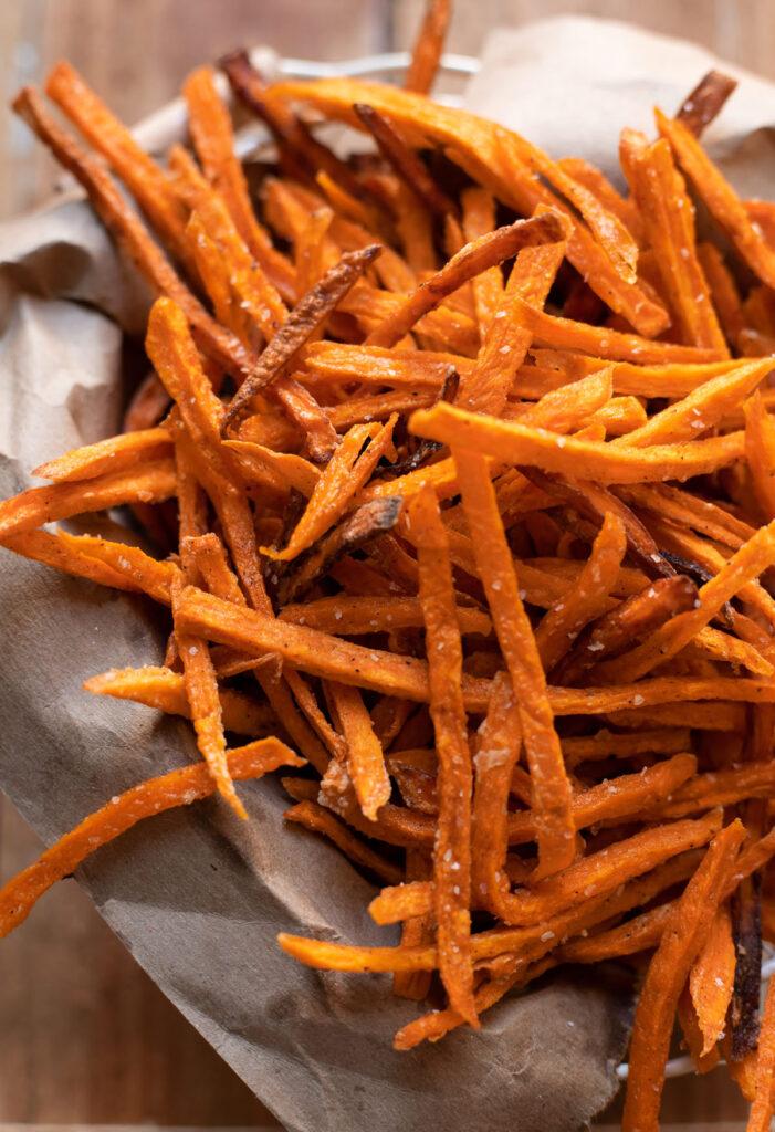 Sweet potatoes cut thin into a fry shape and fried
