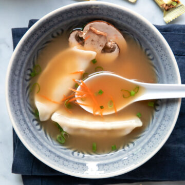 ginger soup with chicken potstickers carrots and mushrooms
