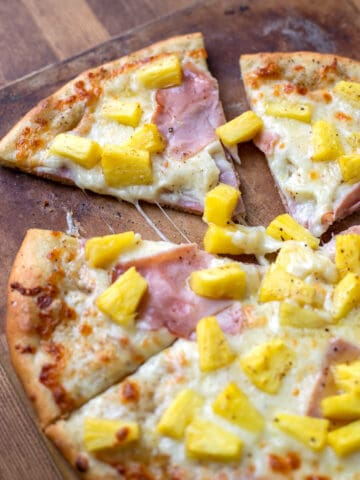 pizza with olive oil mozzarella cheese ham and pineapple