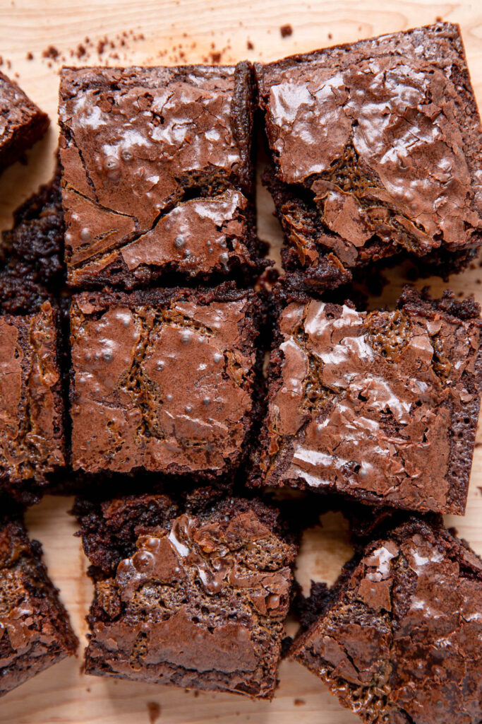 Brownies on a cutting board in squares.
