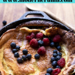 skillet dutch baby with lemon zest blueberries and raspberries