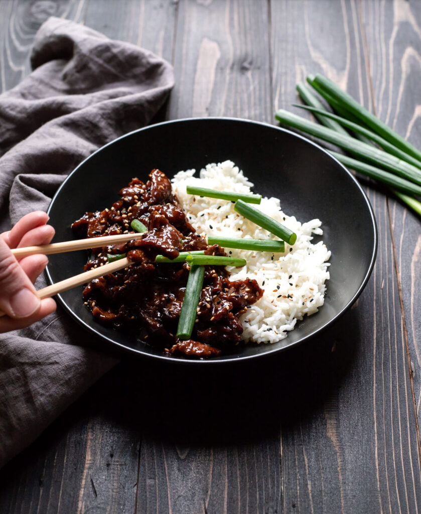 mongolian beef with white rice and green onions