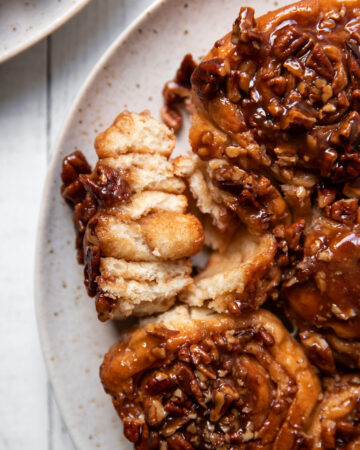 cinnamon rolls with caramel sauce and pecans