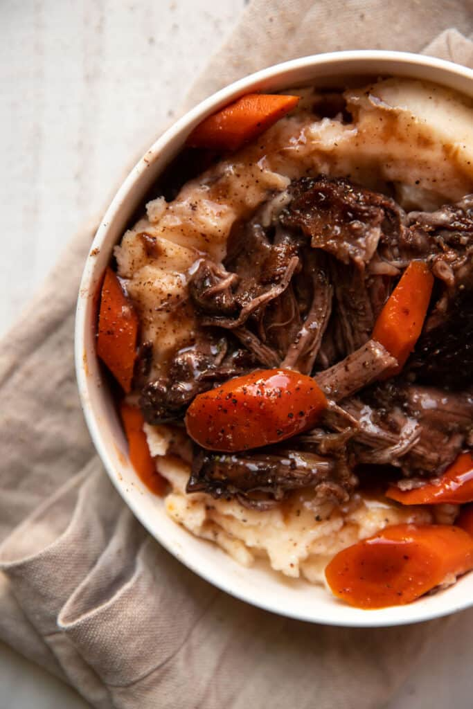 tender short ribs braised in red wine with gouda mashed potatoes and cooked carrots