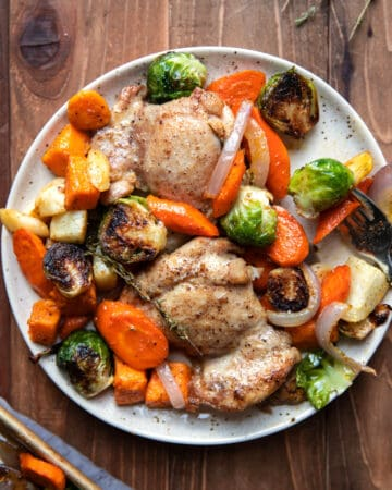 sheet pan with roasted chicken thighs and root vegetables