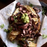 Steak piled high on cheesy french fries topped with guacamole.