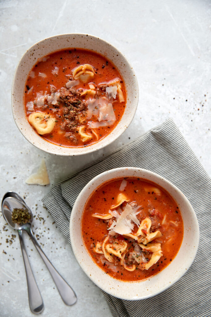 tomato soup with cheese tortellinis and ground beef in a bowl