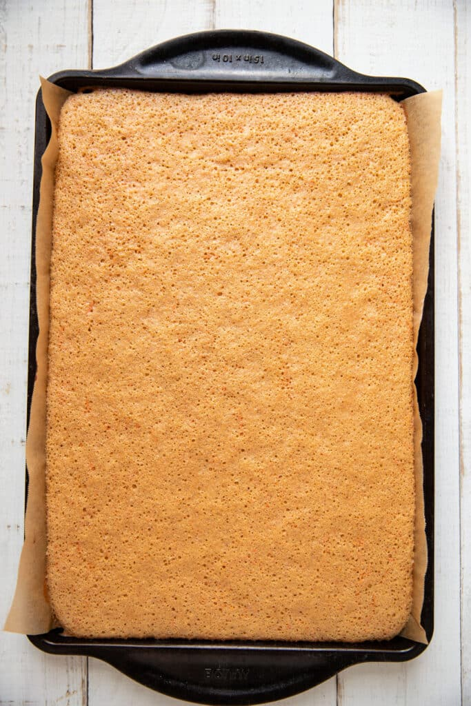 carrot cake roll on a sheet pan