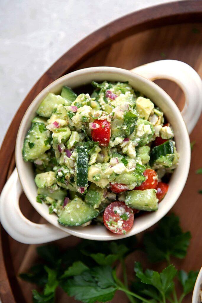 bowl of avocado feta and tomato dip