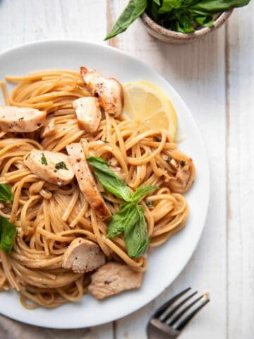 linguine pasta with buttery lemon sauce and fresh basil on top