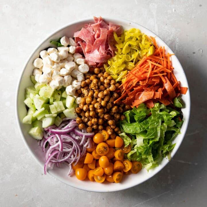 italian chopped salad with roasted chickpeas in a white bowl