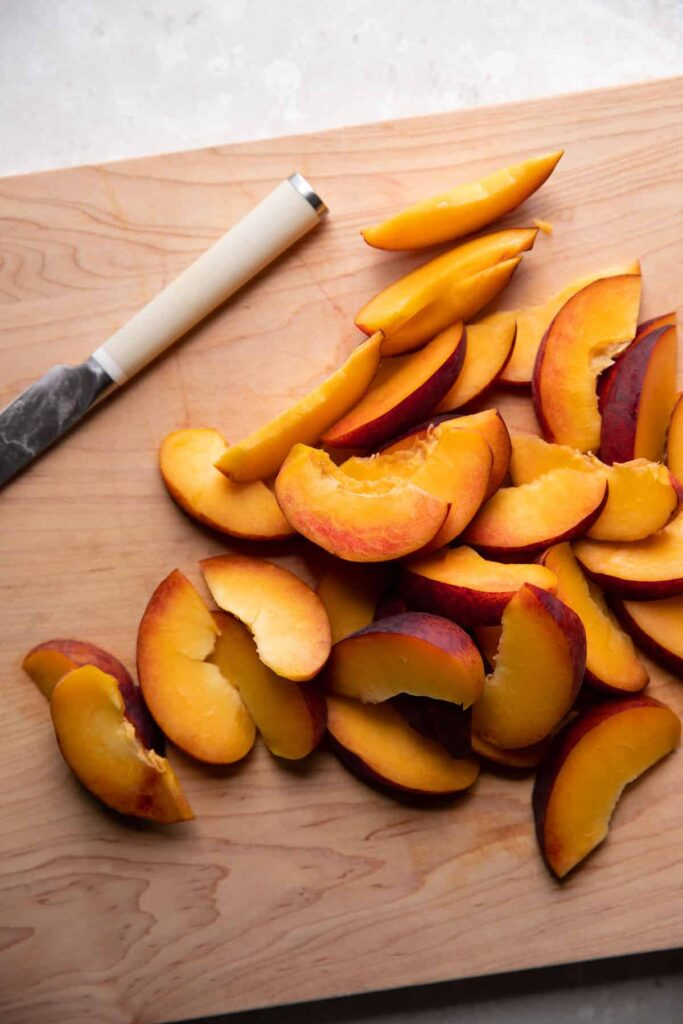 sliced fresh peaches on a cutting board