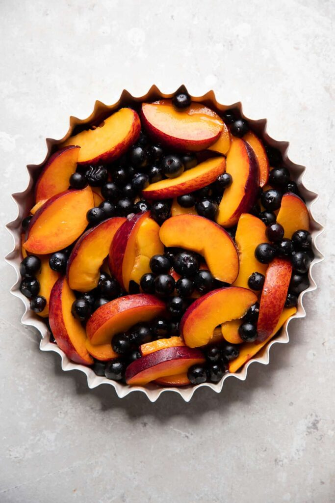 baking dish with blueberries and peaches