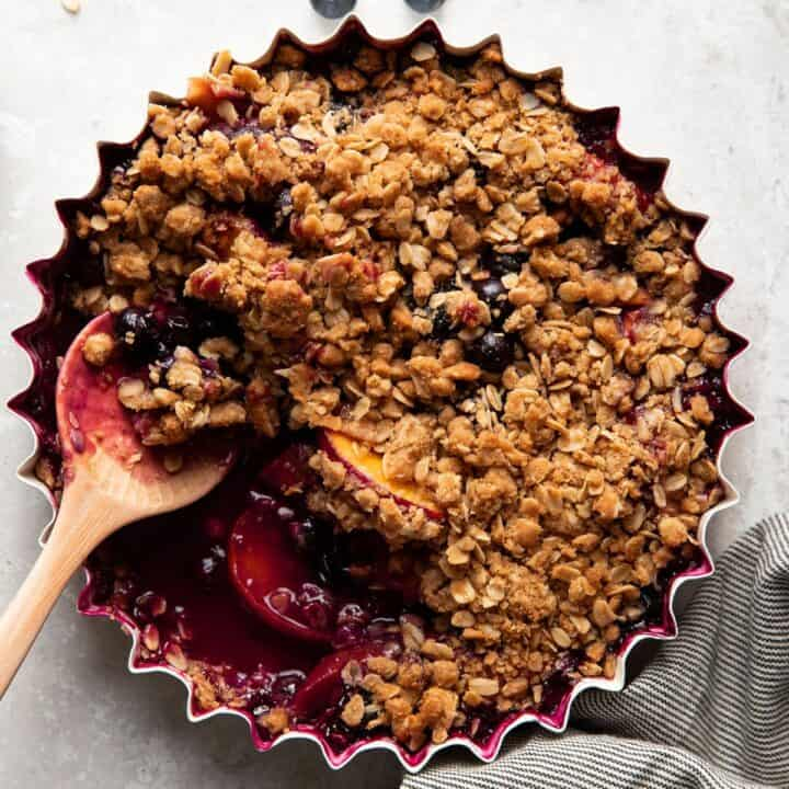 baking dish with blueberry peach crisp after baking