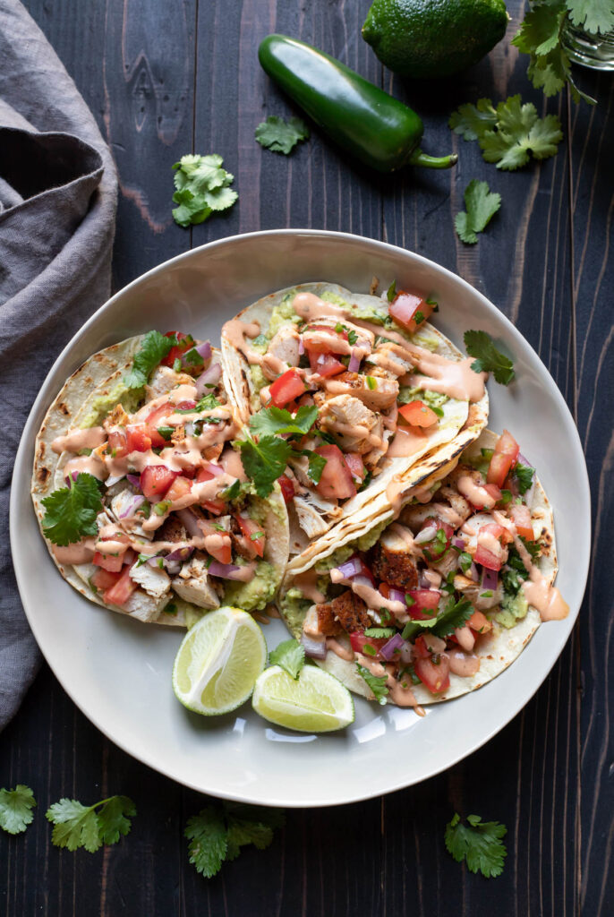 chicken street tacos on a plate.