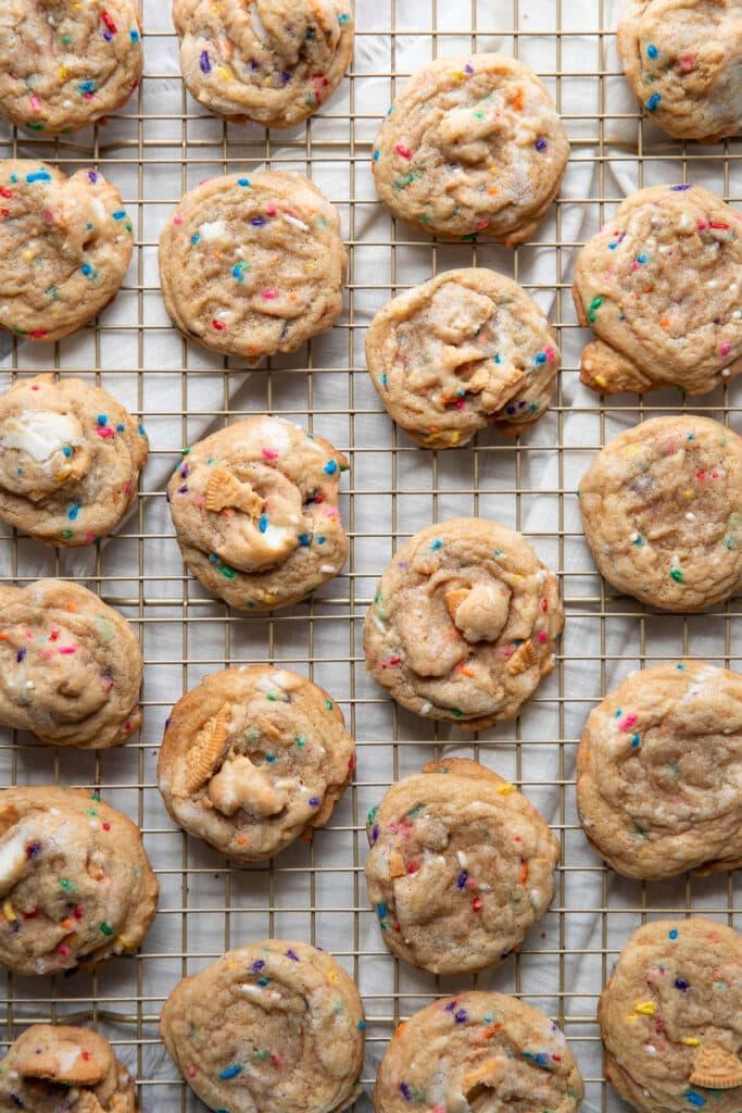 baked sprinkle cookies on a cooling rack