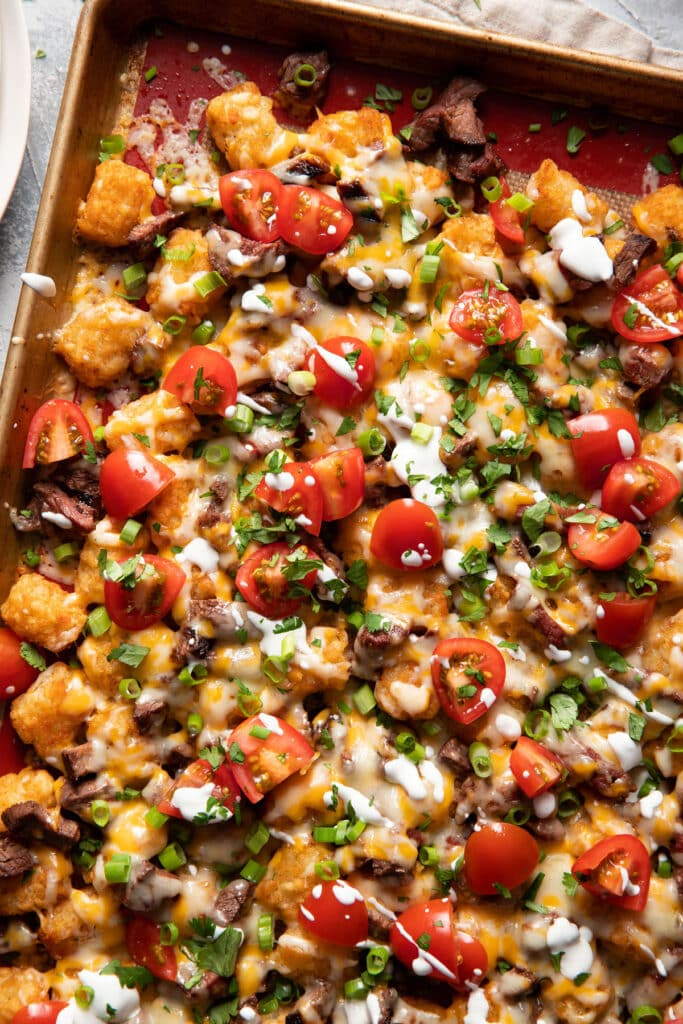 tater tot steak nachos southwest style on a sheet pan