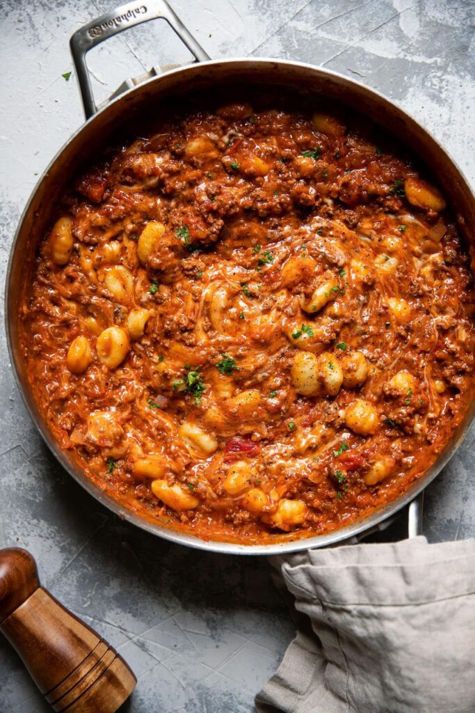 gnocchi marinara and ground beef in a pan