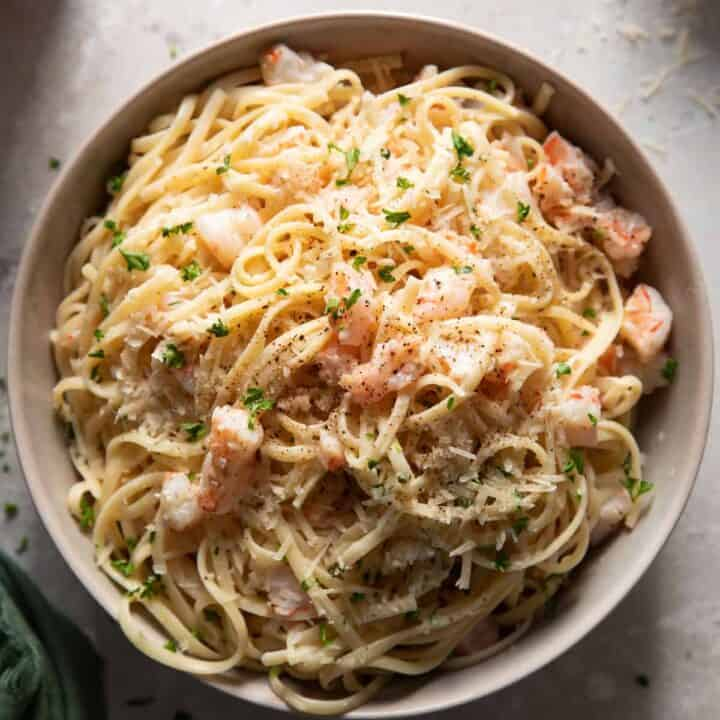 Shrimp scampi and linguine in a grey bowl.