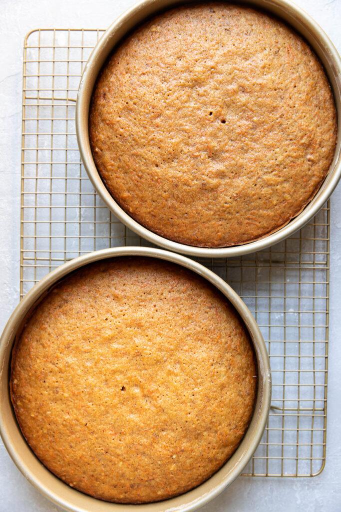 carrot cake in cake pans.